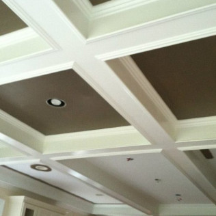 Painting of detailed ceiling and trim.