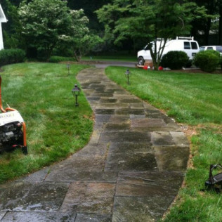 Before power washing stone walkway