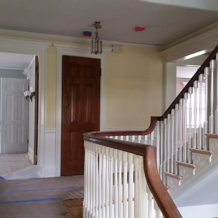 Full repaint of stairway and staining of doors.